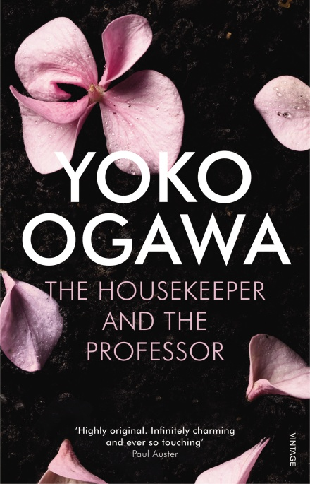 Book cover of 'The Housekeeper and the Professor'. Cover is black, with pink cherry blossoms around the edges. In the centre is the title, written in white text.
