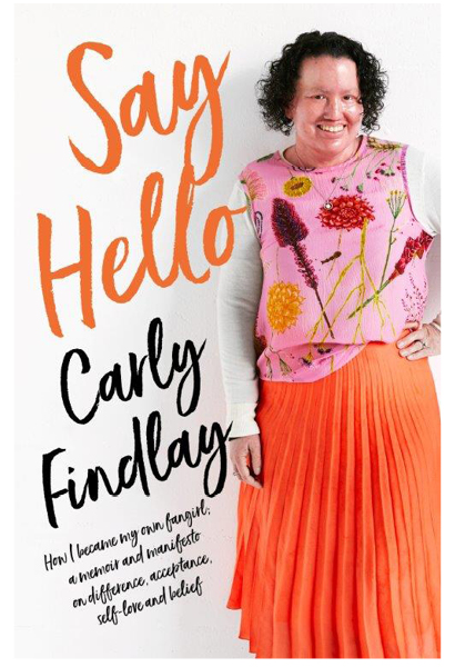 Book cover of 'Say Hello'. Cover is white, with the title in big orange font. The author, Carly Findlay, stands smiling on the right hand side of the cover.