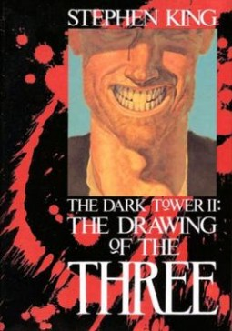 Picture of a grinning face over a blood-splattered cover